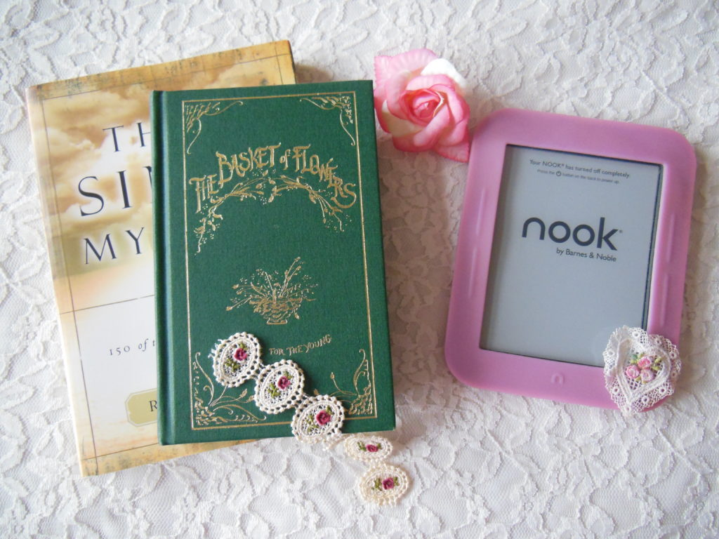 two books and a Nook e-reader
