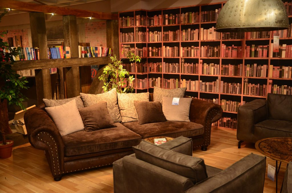 Chairs and a couch in front of a wall of bookshelves