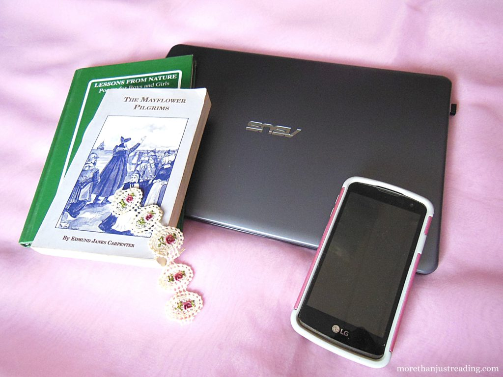 Books, a laptop, and a cellphone