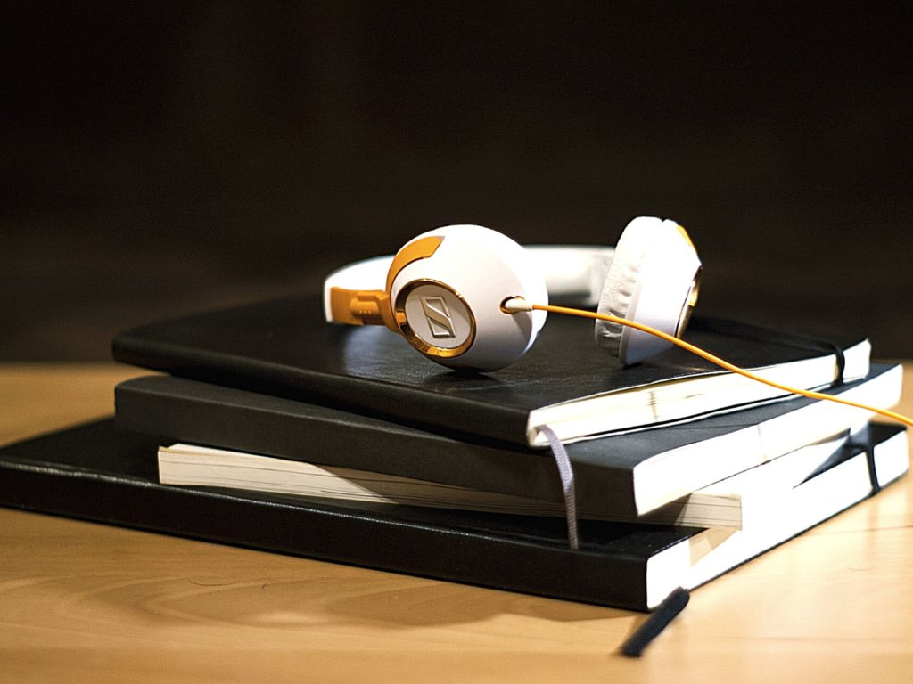 Headphones on a stack of books for helping auditory learners