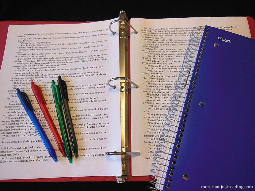 A notebook, paper in a binder, and colored inkpens   Creative writing