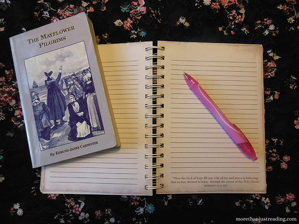 A notebook and pen and book