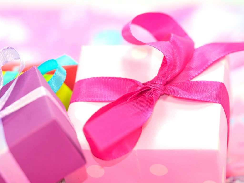 Presents tied with a pink bow