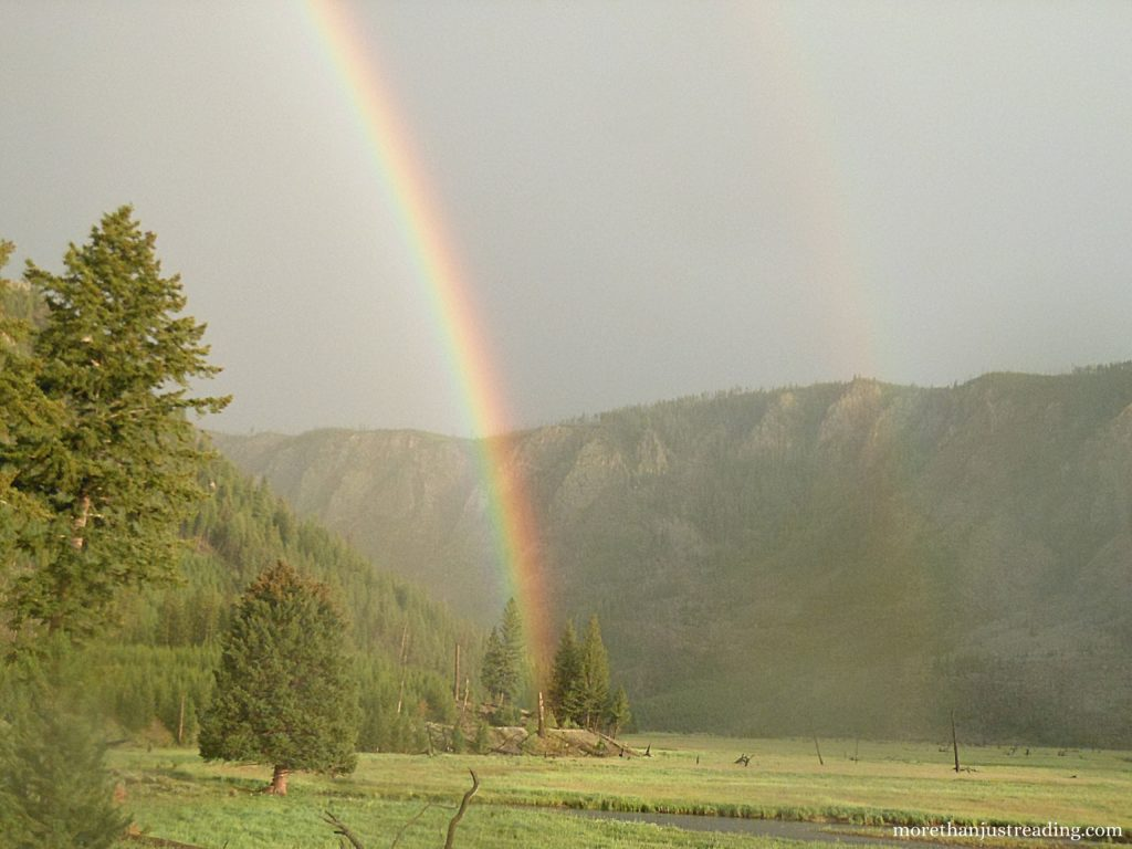 A double rainbow over mountains