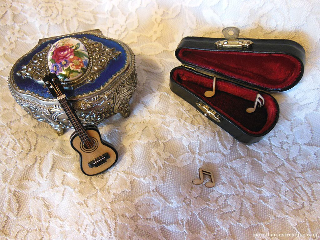 A miniature scene with a guitar and guitar case