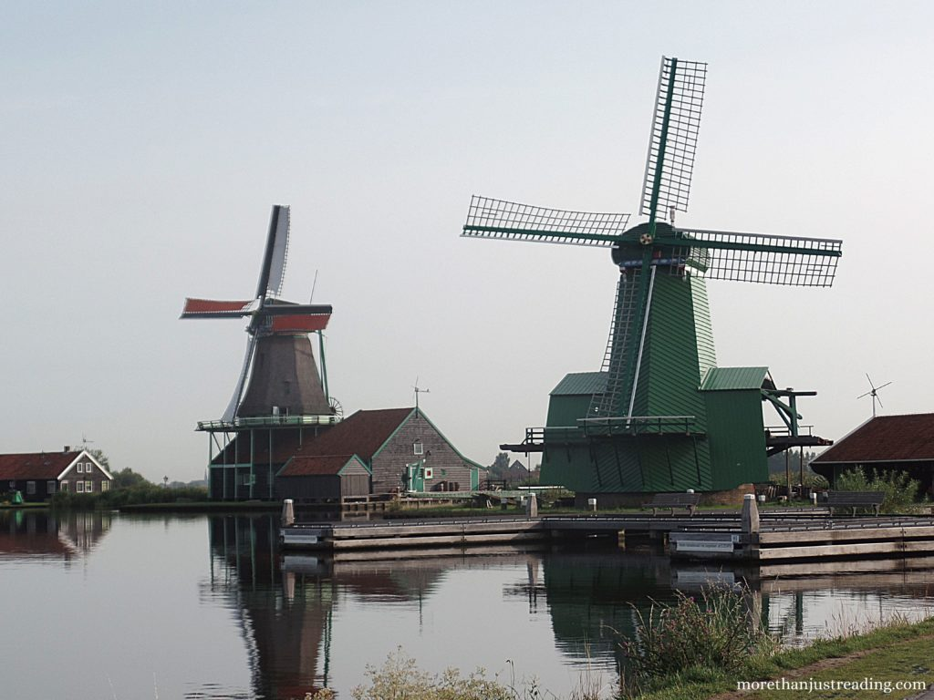 Dutch windmills next to a canal