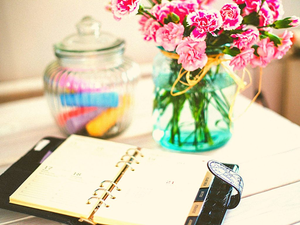 planner, flowers, and glass jar, how to not waste your summer