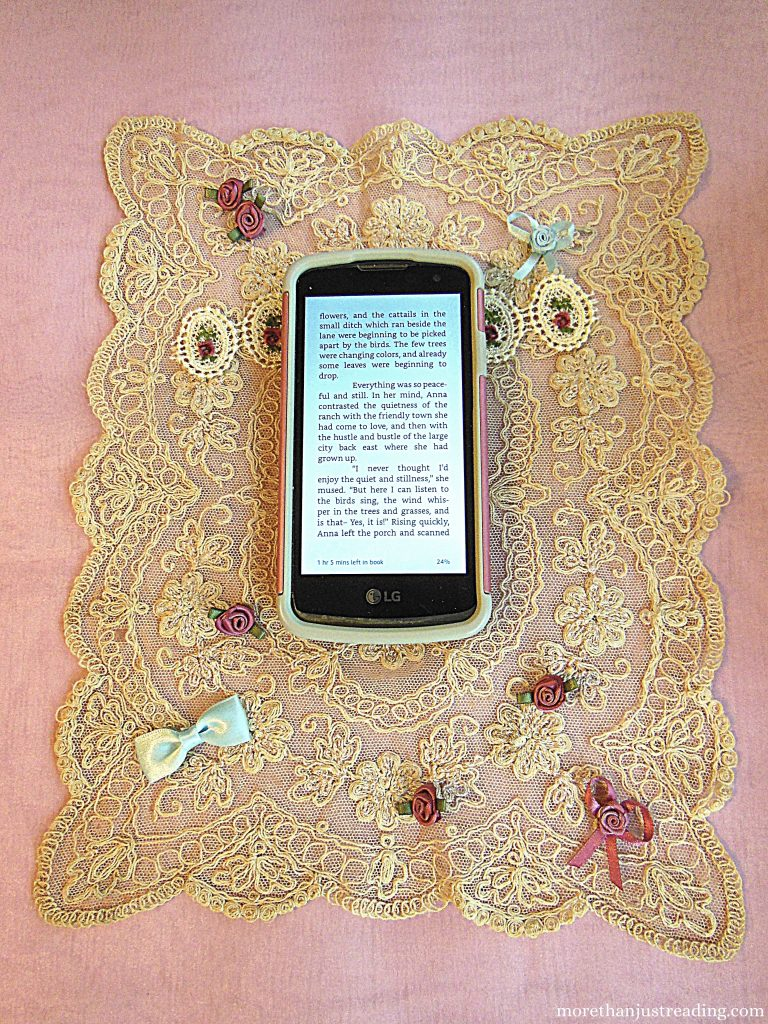 cell phone on lace background | e-readers versus phones
